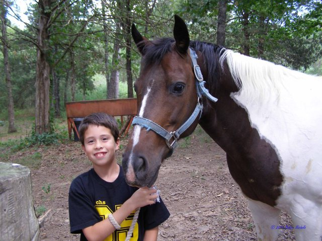 Wordless Wednesday --A few years ago. Caleb Nichols and his first pony, named Paint.