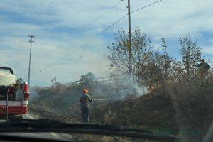 Firemen fight the grass fire