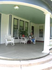 Freeda Baker Nichols, writing on porch of the Pfeiffer House at Hemingway Writers' Retreat