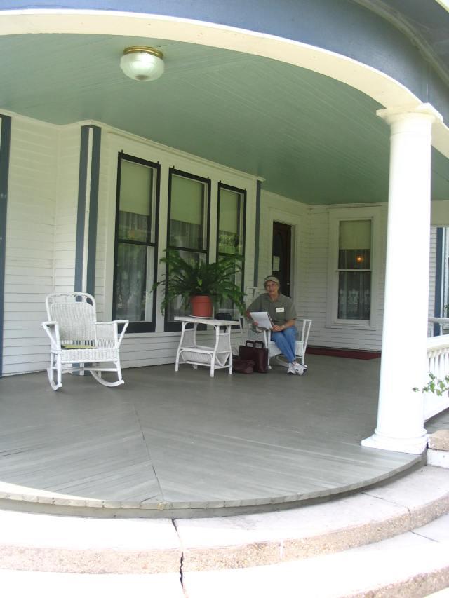 Freeda Baker Nichols, writing on porch of the Pfeiffer House at Hemingway Writers' Retreat